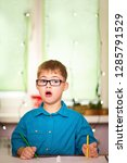 a boy with down syndrome draws... | Shutterstock . vector #1285791529