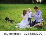 family on a picnic in the... | Shutterstock . vector #1285803220
