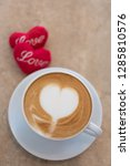 hot coffee cup with red hearts... | Shutterstock . vector #1285810576