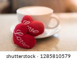 hot coffee cup with red hearts... | Shutterstock . vector #1285810579