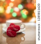 hot coffee cup with red hearts... | Shutterstock . vector #1285811620