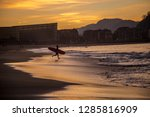 a surfer child entering the... | Shutterstock . vector #1285816909