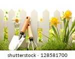 White Fence With Garden Tools...