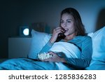 happy woman relaxing in bed and ... | Shutterstock . vector #1285836283