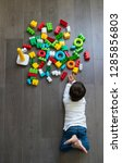 happy baby playing with toy... | Shutterstock . vector #1285856803
