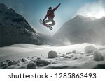 snowboarder jumping in front of ... | Shutterstock . vector #1285863493