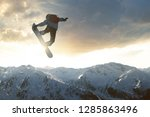 snowboarder jumping in front of ... | Shutterstock . vector #1285863496