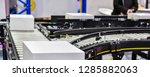 cardboard boxes on conveyor... | Shutterstock . vector #1285882063