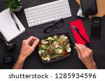 having lunch at workplace.... | Shutterstock . vector #1285934596