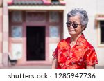 an elderly woman wearing... | Shutterstock . vector #1285947736