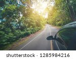 side view of black car driving... | Shutterstock . vector #1285984216