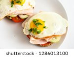 fried egg on wholemeal bread... | Shutterstock . vector #1286013100