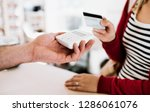 customer and shop assistant... | Shutterstock . vector #1286061076