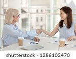 smiling mature company owner...   Shutterstock . vector #1286102470