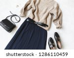 blue midi pleated skirt  beige... | Shutterstock . vector #1286110459