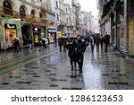 pedestrians walk in the street... | Shutterstock . vector #1286123653