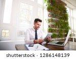 happy businessman wearing shirt ...   Shutterstock . vector #1286148139