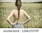 girl in the wheat field. photo... | Shutterstock . vector #1286153749