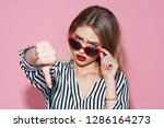 a woman in a striped shirt and...   Shutterstock . vector #1286164273