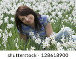 young smiling woman sitting... | Shutterstock . vector #128618900