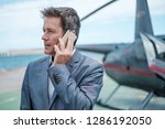 businessman talking on... | Shutterstock . vector #1286192050