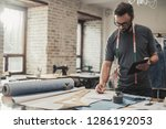 fashion designer working in his ... | Shutterstock . vector #1286192053