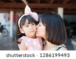 asian mother and child girl ... | Shutterstock . vector #1286199493