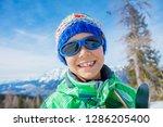portrait of cute happy skier...   Shutterstock . vector #1286205400