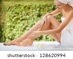 beautiful woman legs and cream. | Shutterstock . vector #128620994