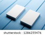business card blank on wooden... | Shutterstock . vector #1286255476