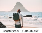 man with backpack walking on... | Shutterstock . vector #1286283559