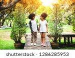children playing in the garden... | Shutterstock . vector #1286285953