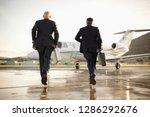 two businessmen running towards ... | Shutterstock . vector #1286292676