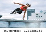 female athlete jumping on to... | Shutterstock . vector #1286306353