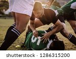 rugby players fighting to get... | Shutterstock . vector #1286315200