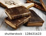 antique books on aged white... | Shutterstock . vector #128631623