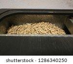 pellets inside the stove | Shutterstock . vector #1286340250