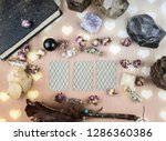 Small photo of Guessing on the cards, dry herbs and natural stones, the book of spells, magic, witchcraft, Wicca