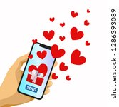 hand holding phone with hearts. ...   Shutterstock .eps vector #1286393089