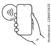 hand holds smartphone near...   Shutterstock .eps vector #1286413633