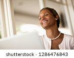 smiling businesswoman working...   Shutterstock . vector #1286476843
