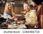 friends having dinner at... | Shutterstock . vector #1286486710