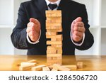 businessmen protect domino to... | Shutterstock . vector #1286506720