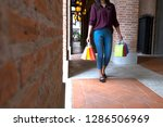 woman holding shopping bag... | Shutterstock . vector #1286506969