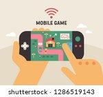 a hand holding a small handy...   Shutterstock .eps vector #1286519143