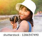 happy young asian woman...   Shutterstock . vector #1286547490