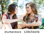 two girlfriends outdoor | Shutterstock . vector #128656646