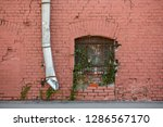 red brick wall with window and... | Shutterstock . vector #1286567170