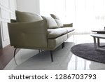 cushioned leather sofa | Shutterstock . vector #1286703793