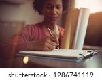 filling out an important form.... | Shutterstock . vector #1286741119